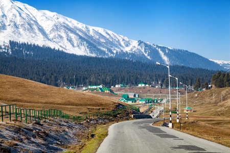 A road leading to Himalayan Mountains through Gulmarg, Jammu and Kashmir, India Stok Fotoğraf