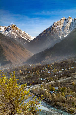 A water stream flowing down the terrains of Himalayan Mountains and passing through a village near Sonmarg, Jammu and Kashmir, India Stok Fotoğraf - 152146859