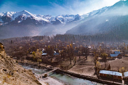 A water stream flowing down the terrains of Himalayan Mountains and passing through a town near Sonmarg, Jammu and Kashmir, India