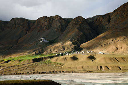 wide shot of Key monastery with spiti river at near Kaza Town, Spiti valley, Himachal Pradesh, India