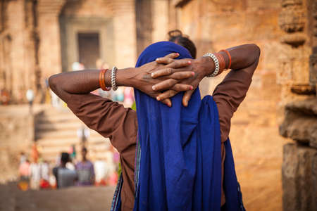 A Traditional indian woman watching the sun temple of Konark.