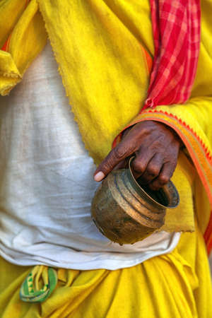 The Indian monk (spiritual man) has a vessel in hand. Stock Photo