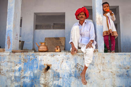 Pushkar, Rajasthan, India - March 23, 2014 : a traditional Rajasthan man with child during a local fair.