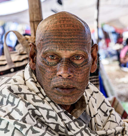 Champa, Chhattisgarh, India - April 22, 2014 - A member of the Ramnami sect, with tattoos and shawl. its adherents tattoo the word