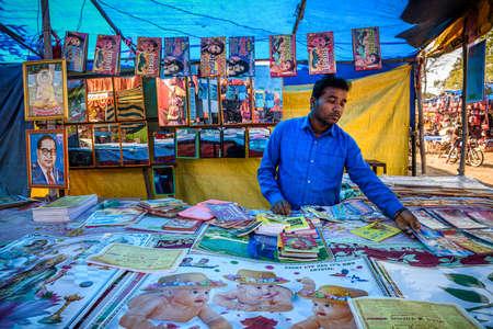 Champa, Chhattisgarh, India - April 22, 2014 - Salesman selling books inside a book stall at an traditional fair. 에디토리얼