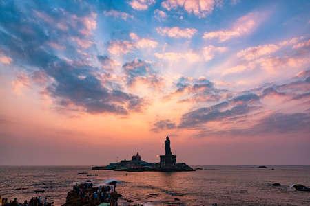 Unidentified tourists take a sunset view of Swami Vivekananda Memorial rock and thiruvalluvar island in Kanyakumari, India