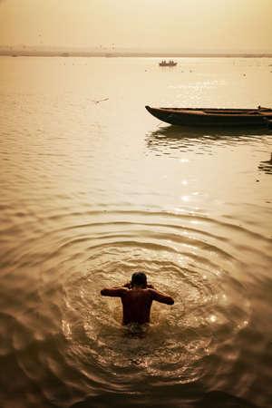 Pilgrims bathing ( Morning activities) at banks of river Ganges Ganga, Varanasi, Banaras, Uttar Pradesh, India.