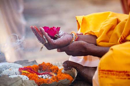 Many flowers is stable for worship on hand at river ganga, varanasi, uttar pradesh, india.