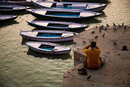 Meditation, Holy man Sadhu meditating at the ghats of Varanasi, Banaras, Uttar Pradesh, India, Asia