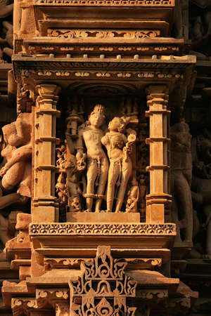 Close up of artful carved walls, Ancient reliefs at famous erotic temple in Khajuraho, Madhya Pradesh, India. Imagens