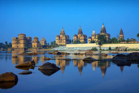 View of Royal cenotaphs (Chhatris) of Orchha over Betwa river. Orchha, Madhya Pradesh, India.
