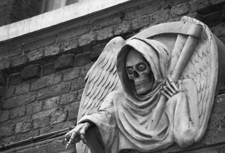 photo of a death statue outside the London Dungeon, UK