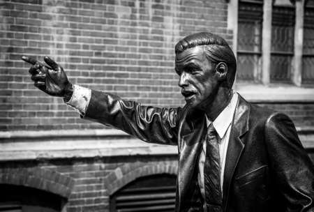 LONDON, UK - MAY 17, 2014: Photo of Taxi, a statue by American sculptor J. Seward Johnson Jr., situated in John Carpenter Street in London. Processed in B&W. Editorial