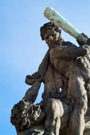 closeup photo of one of the giants at the gates to the Prague Castle in the Czech Republic
