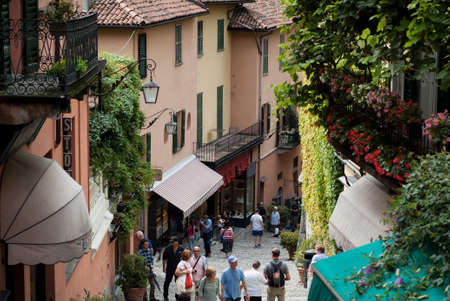 Bellagio, Italy - September 2nd, 2015: tourists walking up and down the narrow hilly paths of Bellagio, one of most popular tourist locations near Lake Como, Italy. Editoriali
