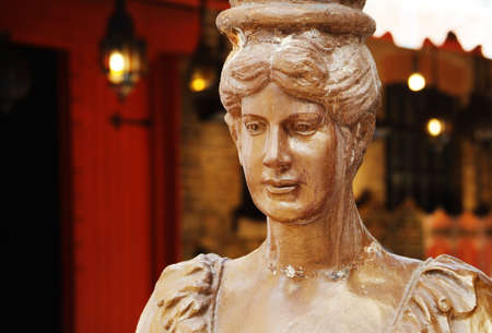 golden column shaped like a lady, Camden Market, London, UK Banco de Imagens