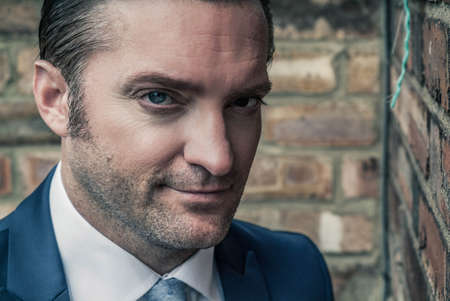 closeup portrait of a handsome man in a smart suit
