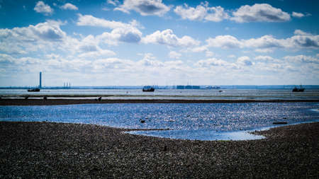 photo of the pebbly Chalkwell beach during low tide hours Stock Photo