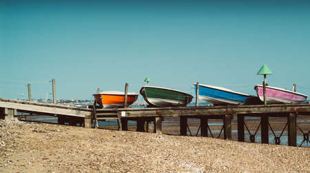 colorful boats photographed on the beach in Essex, UK