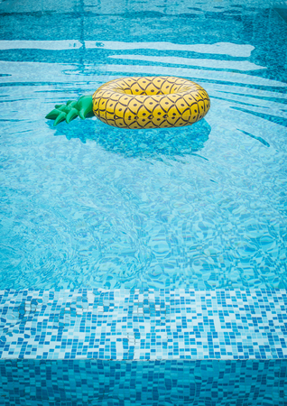 Life ring pineapple In the pool summer