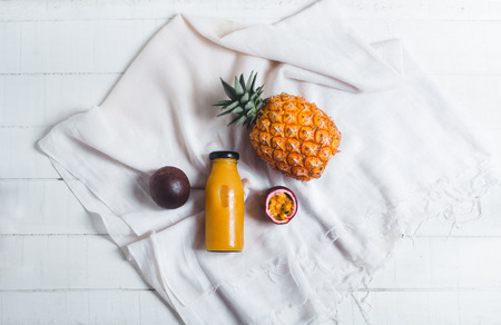 Pineapple and passion fruit juice In the White table background Archivio Fotografico