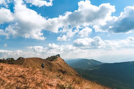 Trekking the backpackers on the golden mountains with bright daytime skies, Mon Jong chiangmai