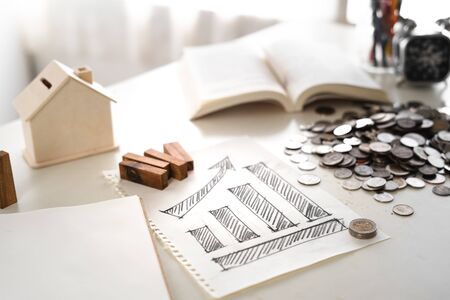 Financial growth-Stacked gold coins On the desk and smartphone