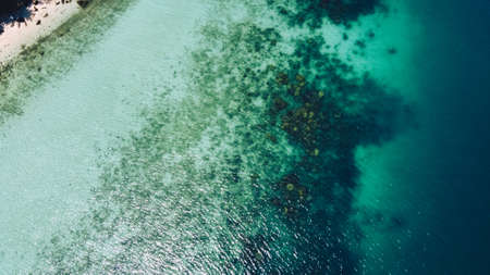 Clear water on the island,Bright blue sea and beach Bird's Eye View Banco de Imagens
