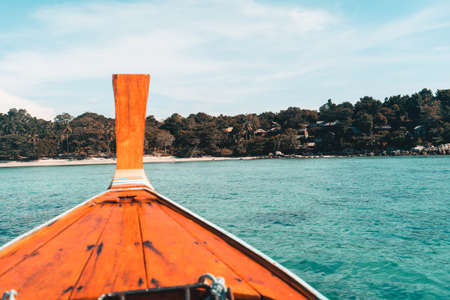 Island tour by long tail boat,Long-tailed boat prow in the blue sea and clear sky. Stock Photo