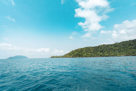 Tropical island and clouds from the boat. Sea travel