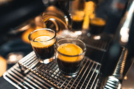 Espresso in a cup from a home maker