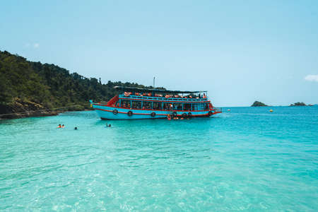 Scenery of tropical island and boat. Sea travel Éditoriale