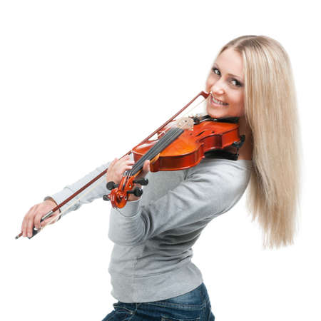 young smiling girl playing the violin photo