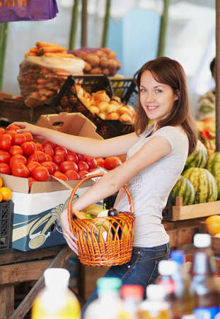 The smiling girl is in the market Stock Photo - 16143004