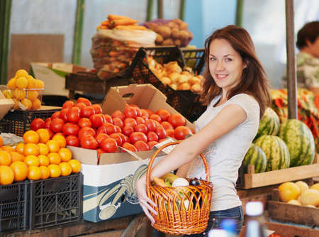 The smiling girl in the market and choosing the food Stock Photo - 16143030