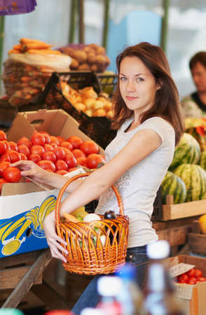 The girl is choosing the food in the market Stock Photo - 16143016