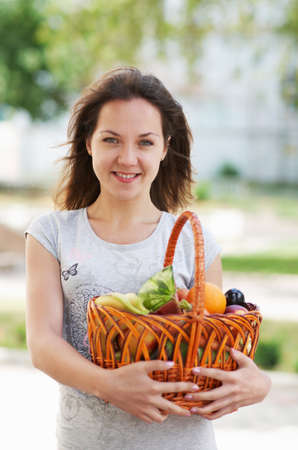 The caucasian girl with basket of food in the street Stock Photo - 16143067