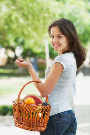Girl with a basket of fruit and vegetables Stock Photo - 16143089