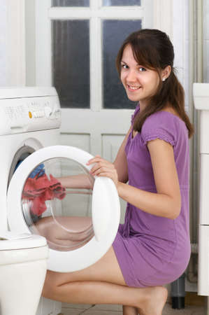 The beautiful girl is washing clothes photo