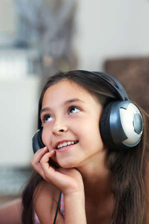 only 1 girl: The young girl is listening to music