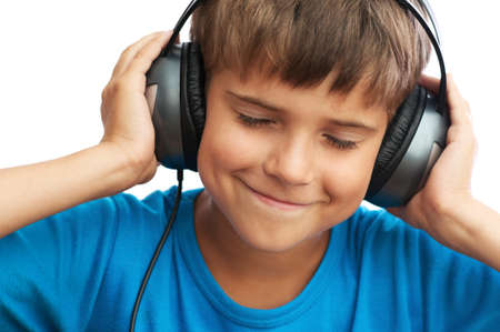 The young boy is listening to music photo