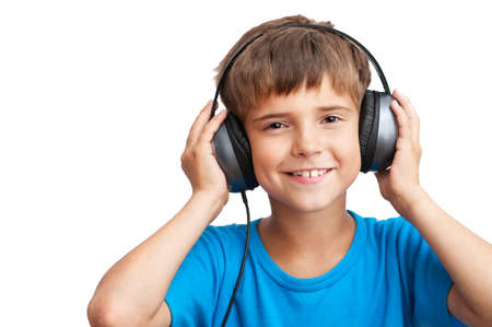 The young boy is smiling and listening to music photo