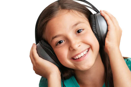 child singing: The girl is holding the headphones and smile