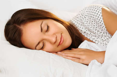 beautiful girl sleeps in the white bedroom Stock Photo - 16142887