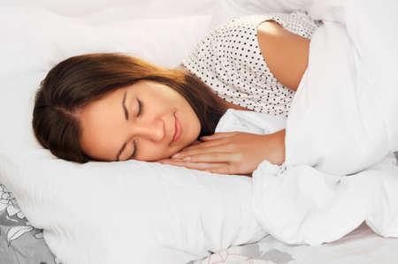 beautiful girl sleeps in the white bedroom 写真素材