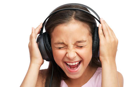 The girl  is  listening to music and close her eyes