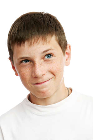 tricky: Portrait of young smiling boy facing up