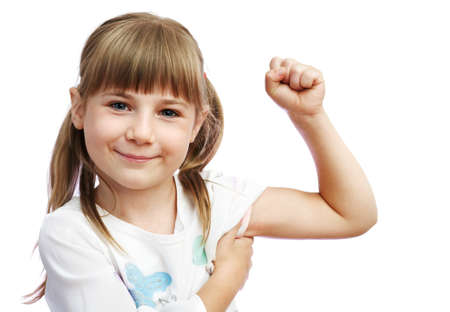 The little girl shows the biceps photo