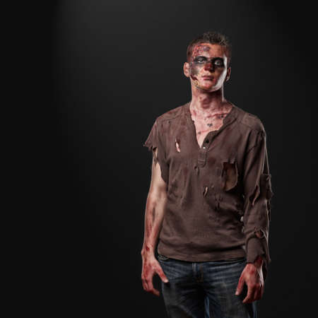 The zombie in the brown shirt