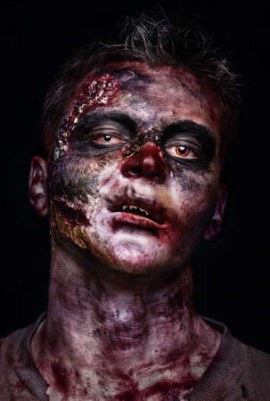 body wound: portrait of scary bad zombie at night Stock Photo